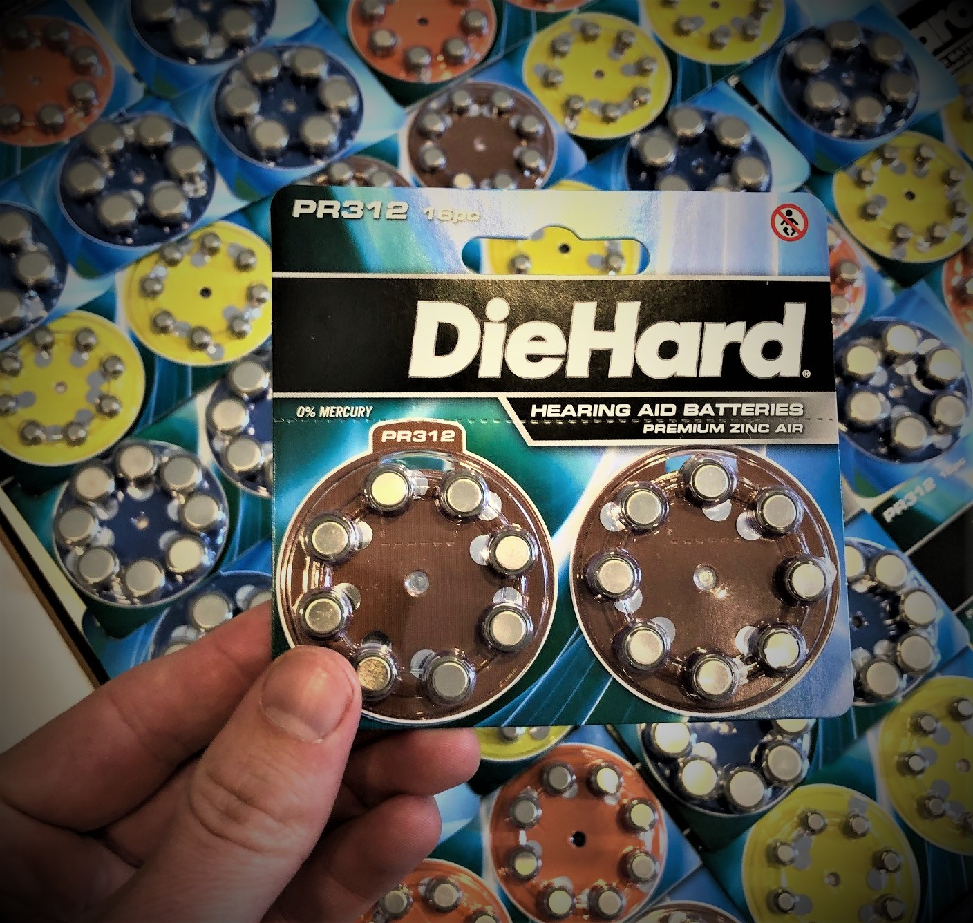 size 312 hearing aid batteries held over size 10 hearing aid batteries, size 13 hearing aid batteries, and size 675 hearing aid batteries