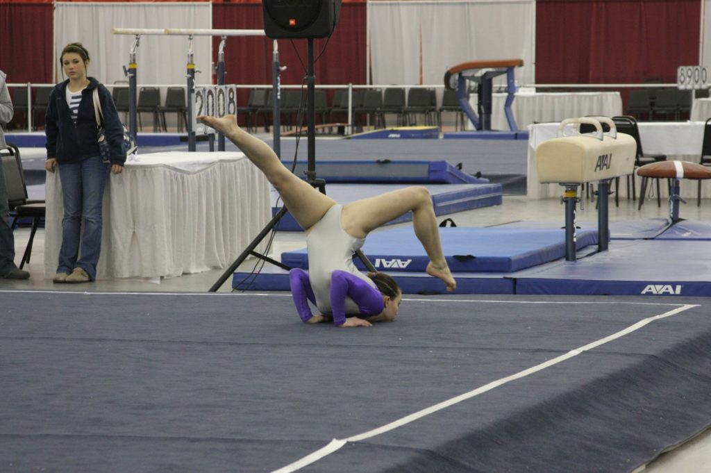 girl performing her gymnastics floor routine