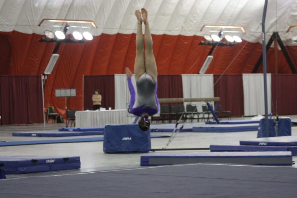 girl performing gymnastics floor routine