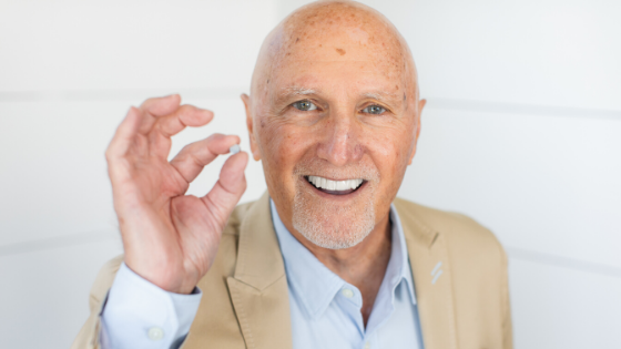 man with hearing aid battery